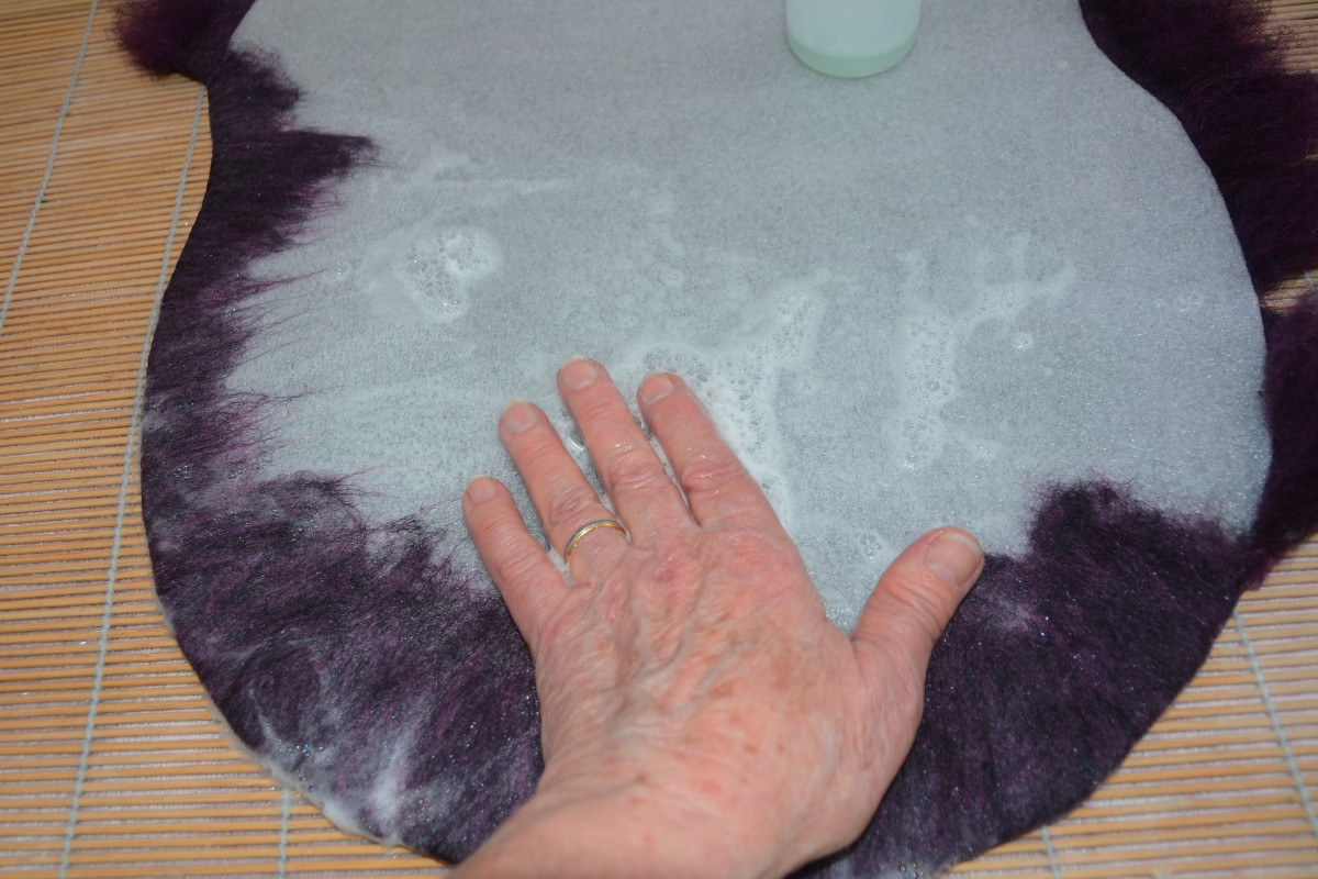 Turn over any excess wool using warm soapy water and your fingers.
