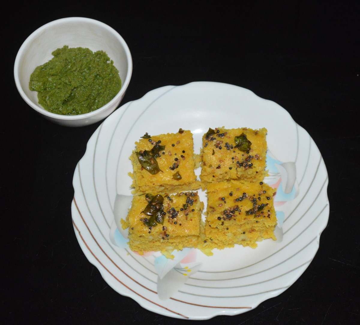 Cut it into equal-sized square pieces. Serve hot with green chutney or tomato sauce. Enjoy this delicious and healthy snack!