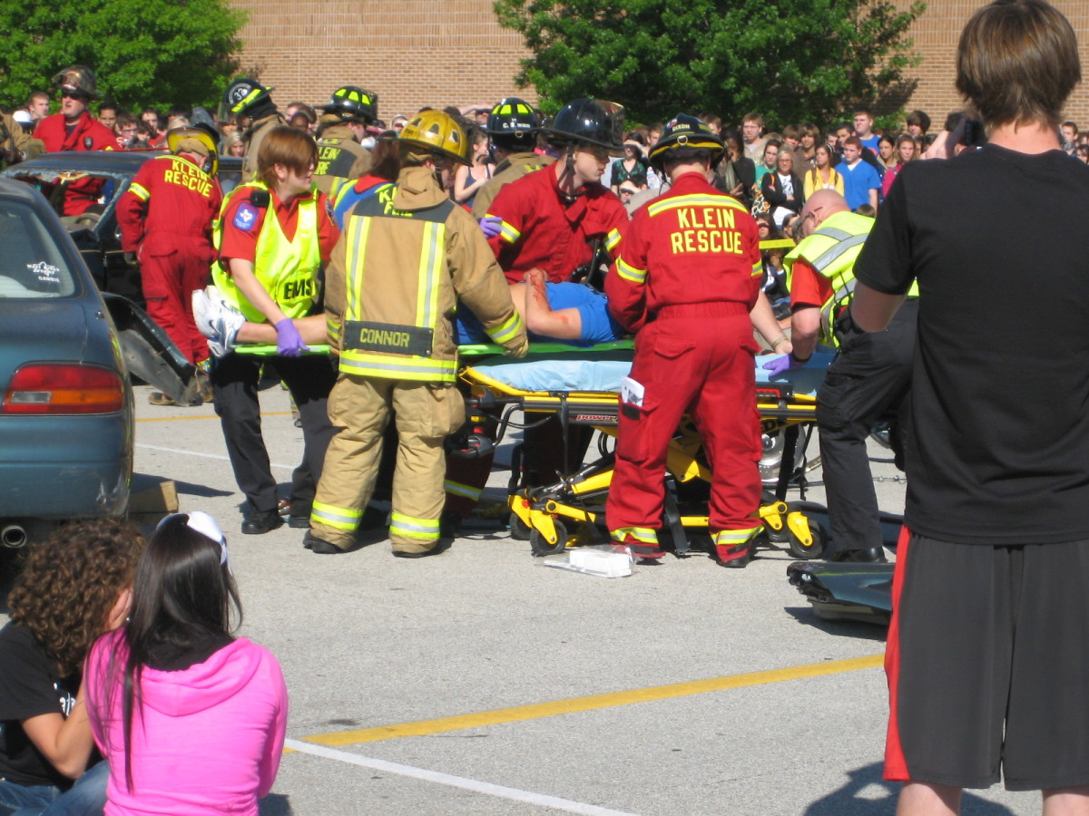 Firemen and EMT's performing a rescue.