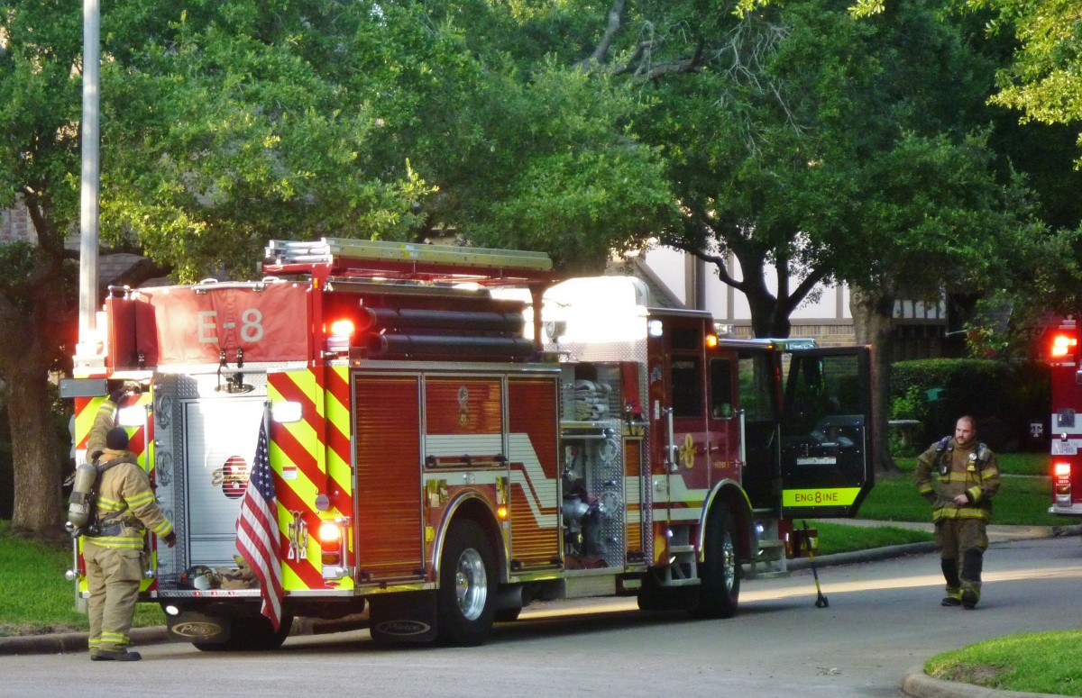 Firetruck and volunteer firemen on our street