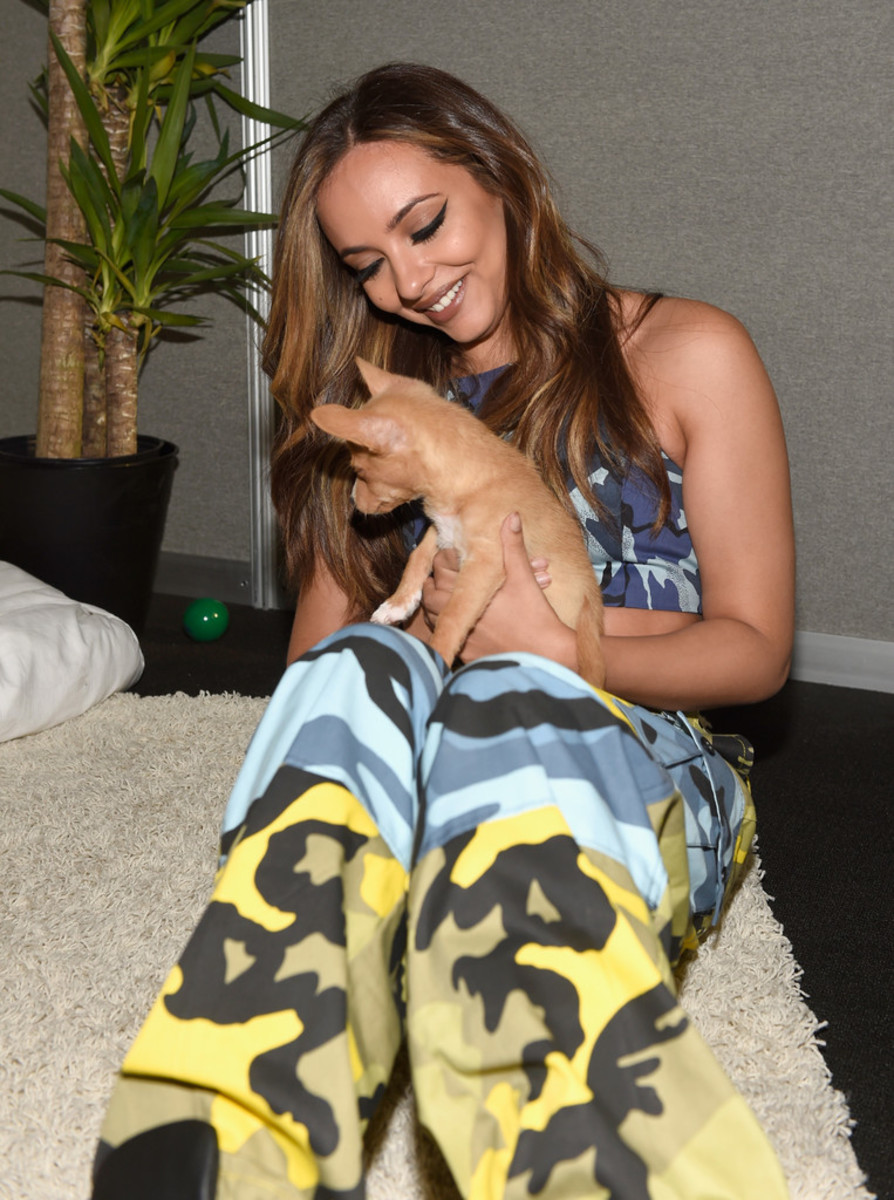 Jade Thirlwall smiles and gives this dog a lot of love and attention. She is seen here during the IHeart Music Festival in fabulous Las Vegas, Nevada in September 2017.