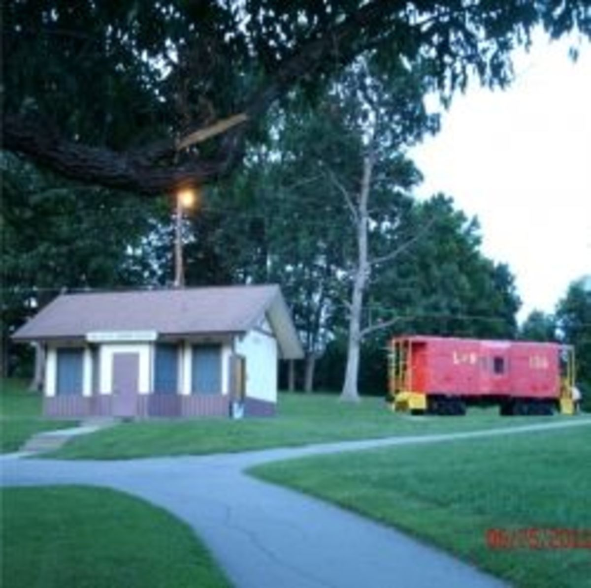 Red Caboose Park's Comfort Station and little red caboose