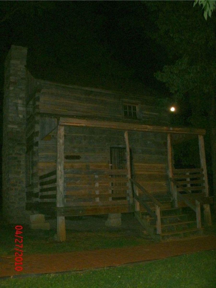 Log cabin by moonlight