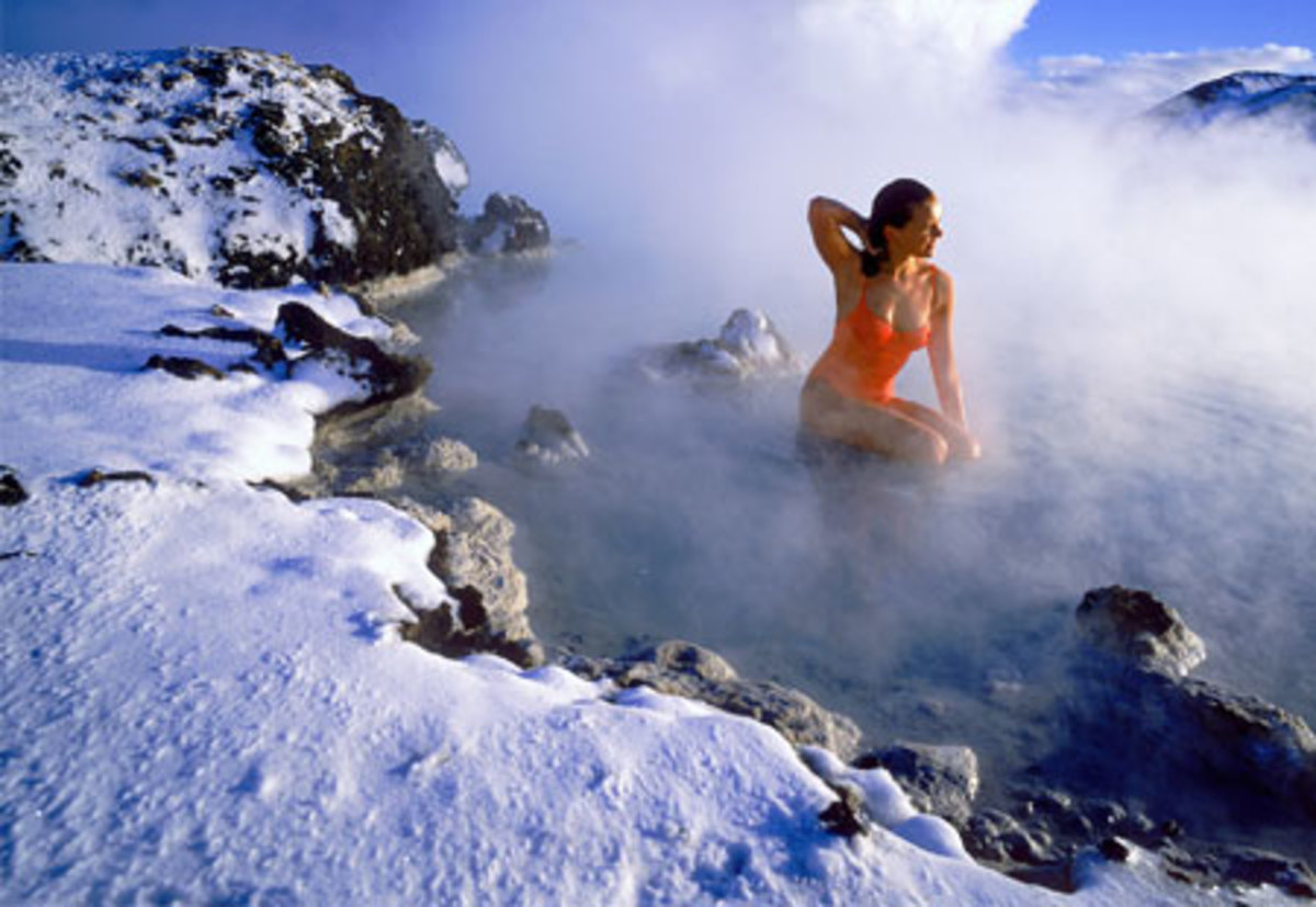 one of Iceland's hot springs where the water stays at 100 degrees year round, regardless of snow on the ground