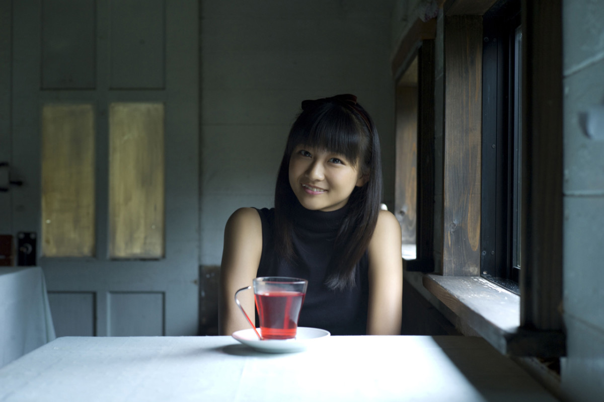 Ayaka Wads about to enjoy what looks like a cup of black tea.