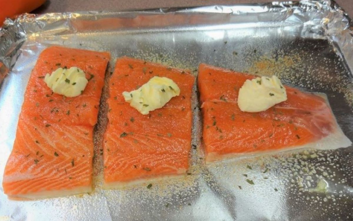 Cut the fillet with scissors and place skin-side down on a cookie sheet covered with foil.