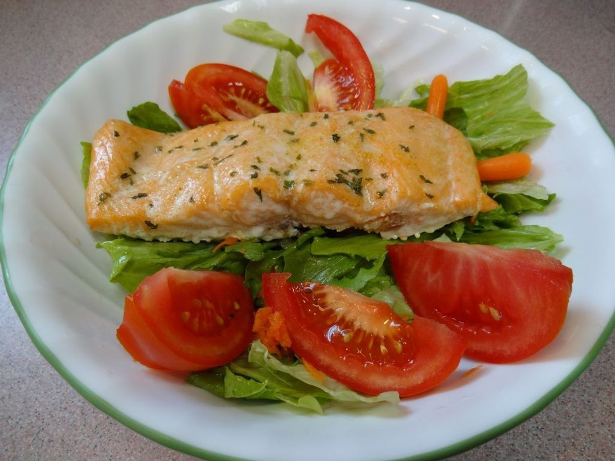 Place the baked salmon fillet on a bed of prepared greens for a quick lunch or dinner.