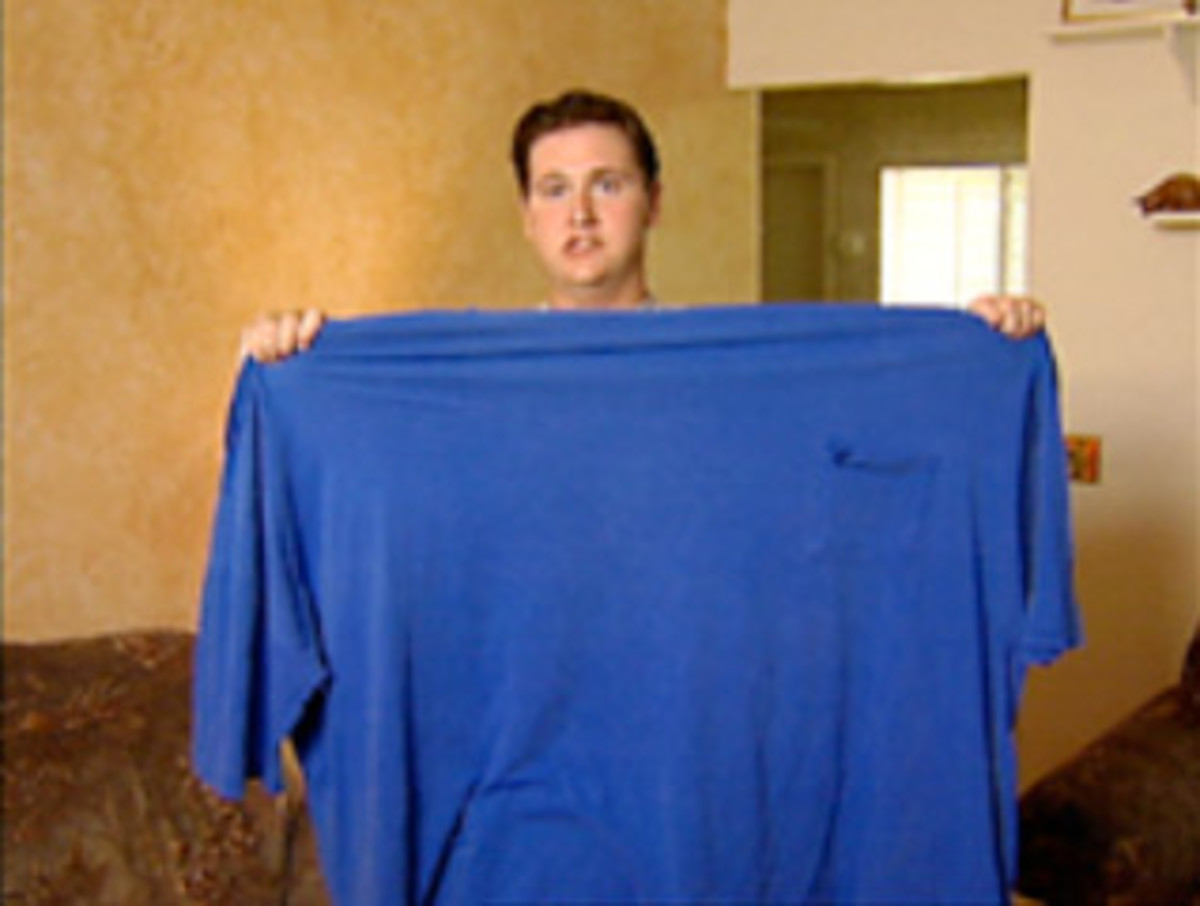 Snith holds up the blue shirt that he constantly used to wear