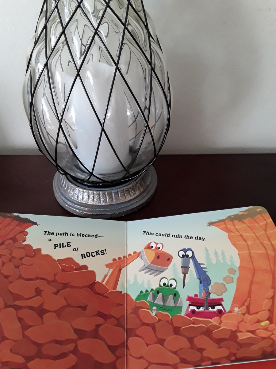 dinosaurs-and-big-trucks-that-dig-in-adventurous-board-book-for-the-little-ones