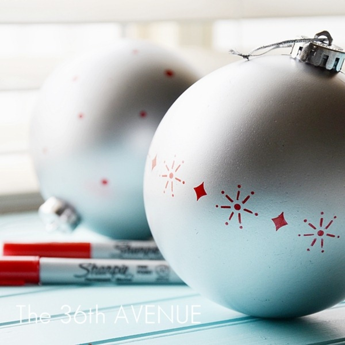 Use sharpies to revive and enhance a Christmas ball. Metallics would be perfect for this kind of project. Ypu do not have to freehand draw. Use a stencil instead.