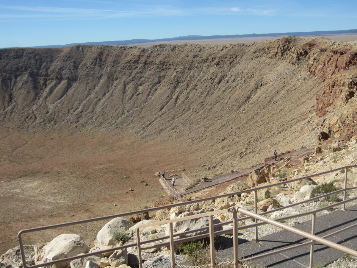 Looking down from the top of the observation deck at my wife (white jacket in the middle of lower platform) on the platform just above the floor of the crater.