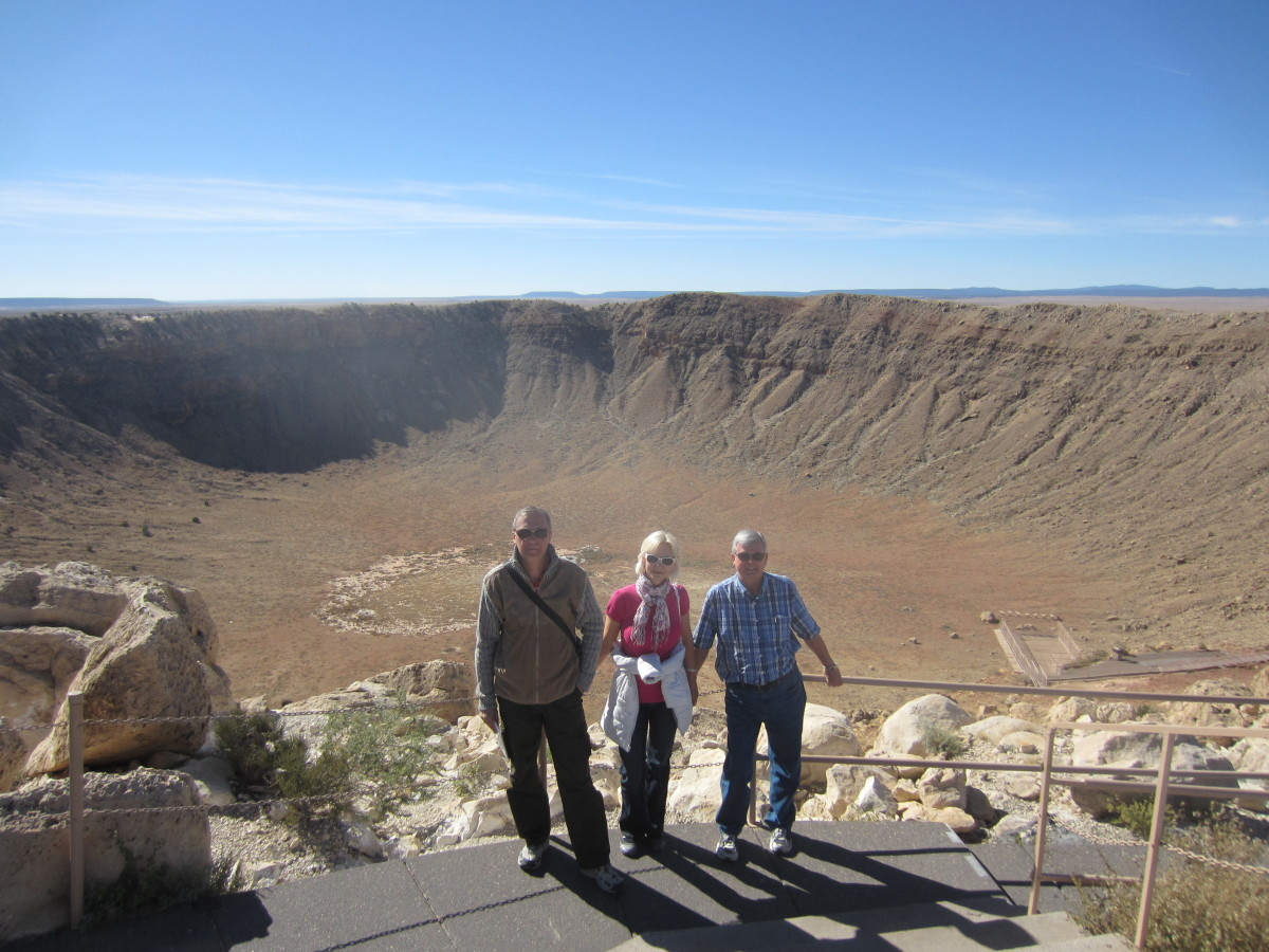 My wife with her brother on her right and me on her left posing above the Meteor Crater.