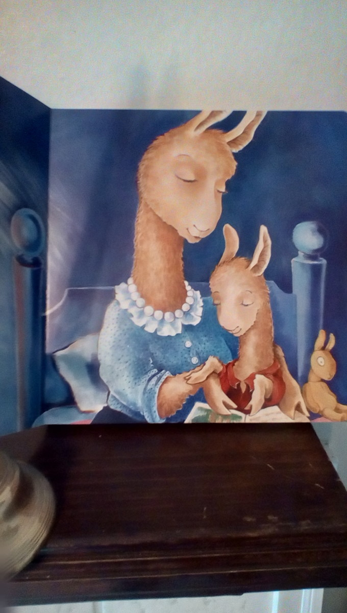 Mama llama reads a story to her little one