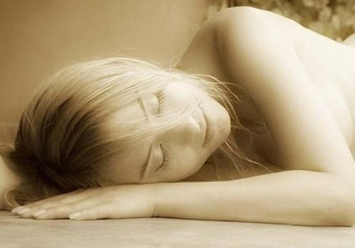 A sleeping woman rests peacefully as she escapes from the concerns of the day.