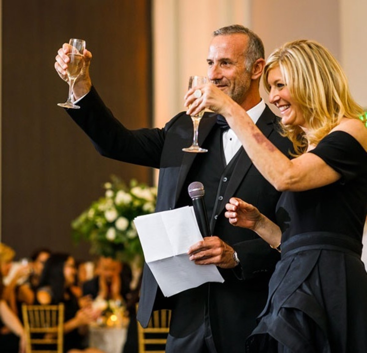 Jewish parents toast their daughter together on her wedding day.