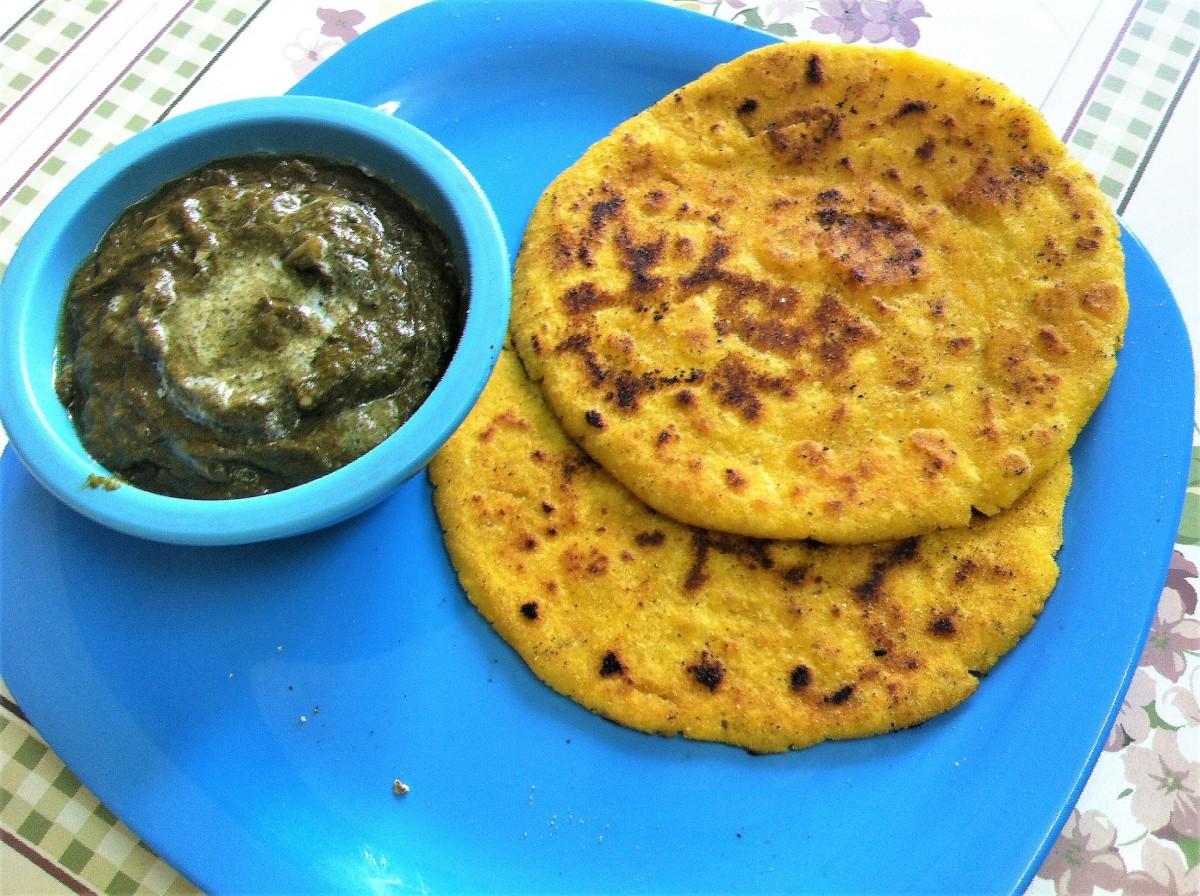 Maize flour flatbread served with sarson ka saag (mustard greens curry)