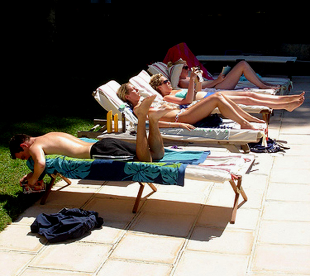 Sunbathing may be a fun social outing, but it exposes your skin to harmful UV rays.