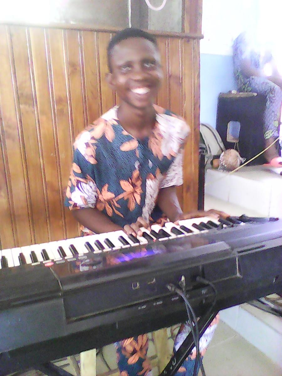 Elijah Playing Piano at C.A.C. Oke-Iyanu, Airport Road, Ilorin.