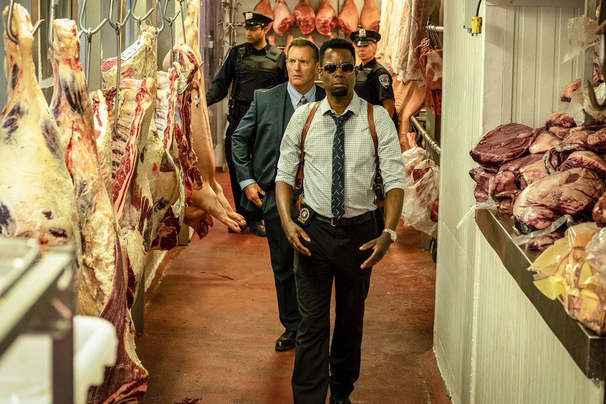 "Zeke (Chris Rock) walks through a hobby shop turned meat market in, ""Spiral."""