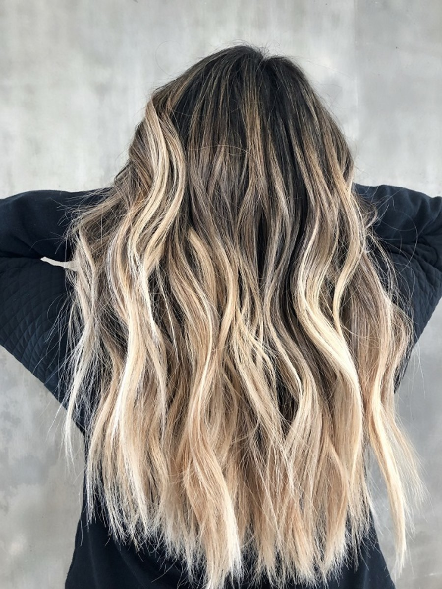 Using a balayage technique can help create multi-dimensional darker blonde shades that match your features.