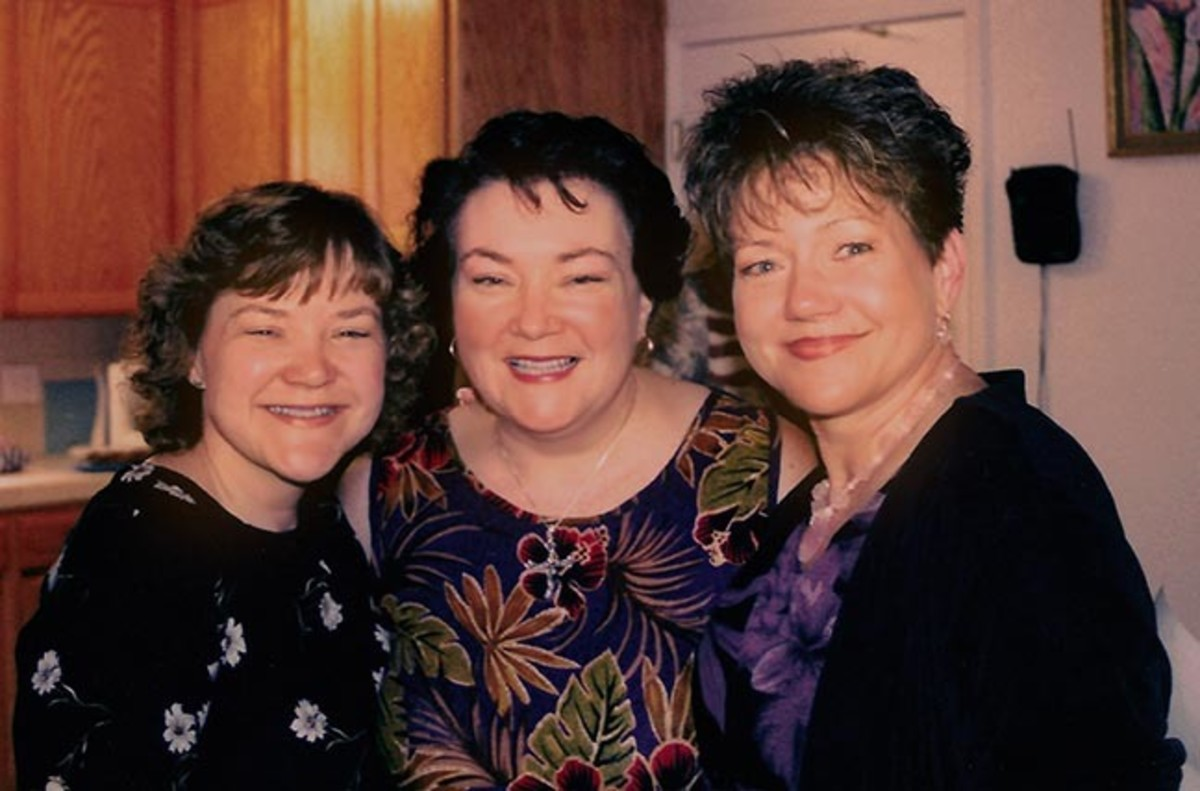 Happy me between my sisters.