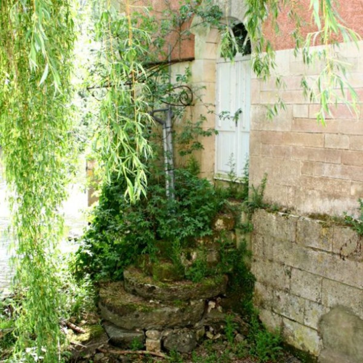 Rear entrance to the mill made from mill stones
