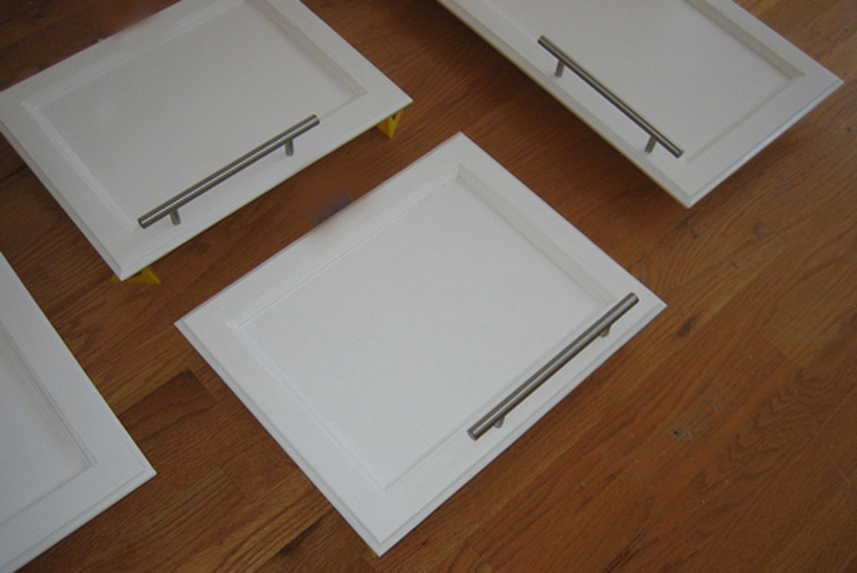 Sleek, brushed nickel handles on Shaker style cabinet doors are a stylish combination.