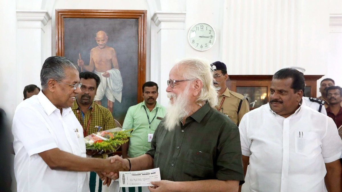 Kerala CM giving check