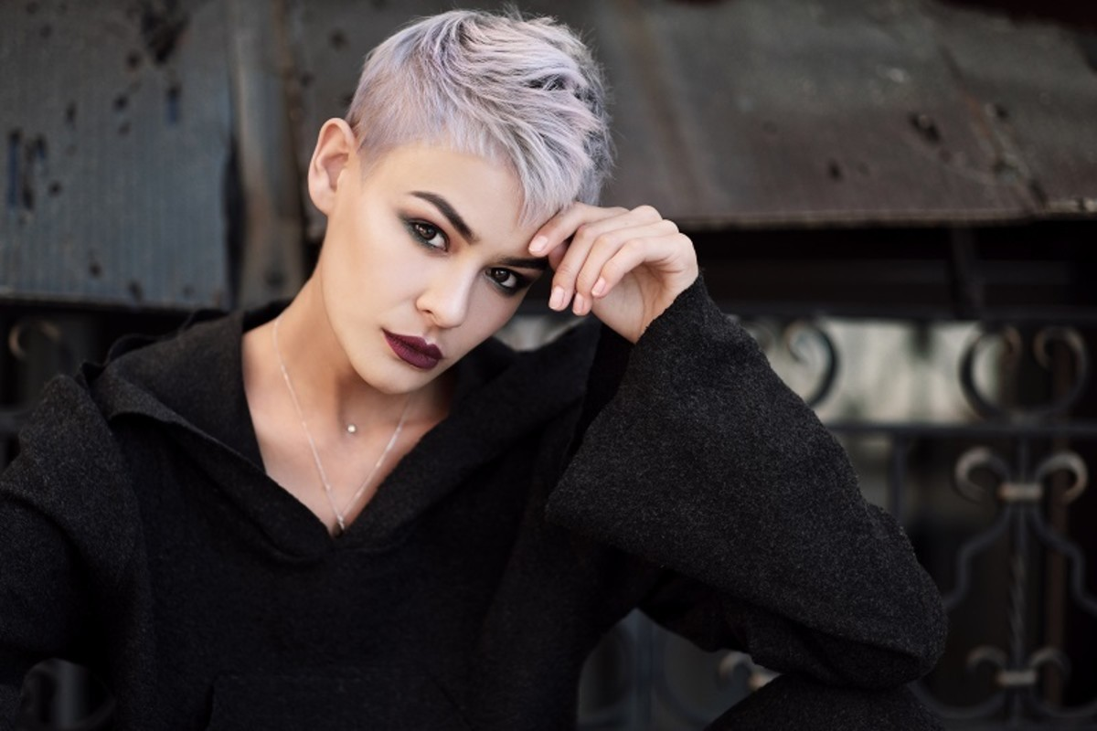 Platinum blonde hair intentionally over-toned using a pearl blonde shade for a sleek, violet-silver look.