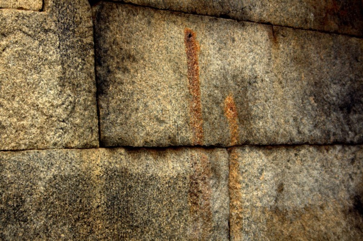 What are the red blotches on the walls of the unfinished marriage hall within the temple?