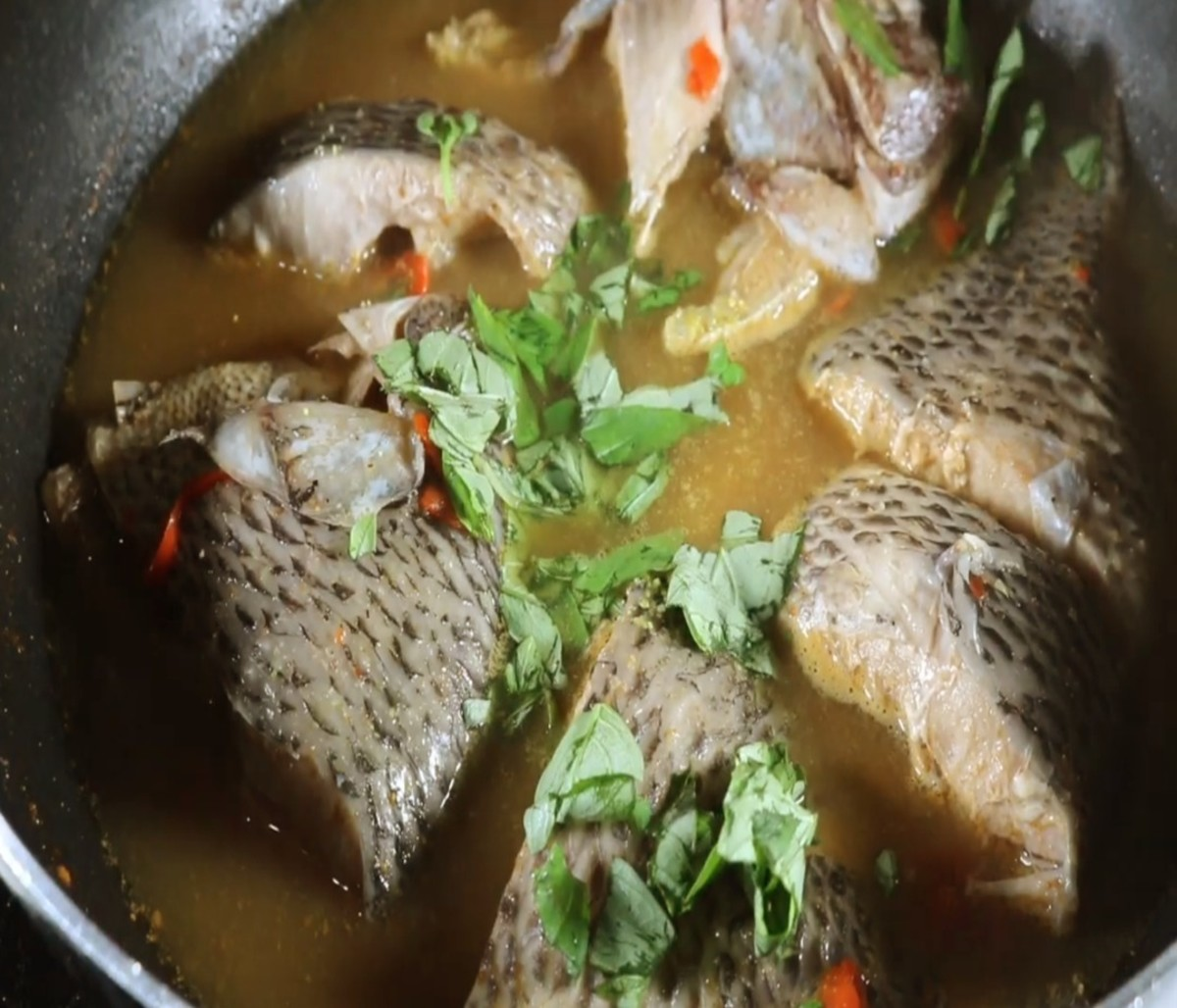 Garnish the fish pepper soup with cilantro before serving
