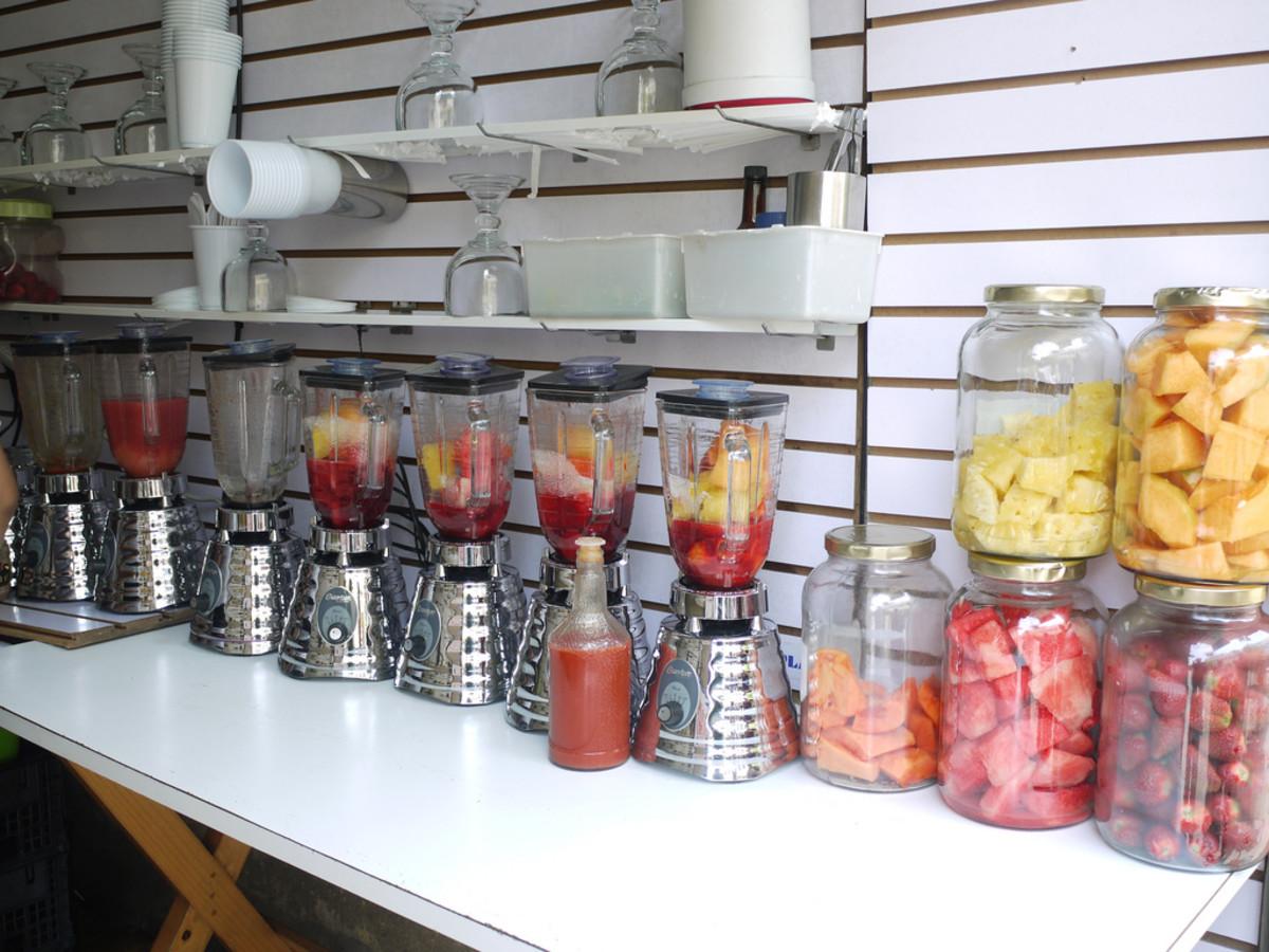 Many varieties of breakfast fruit smoothies