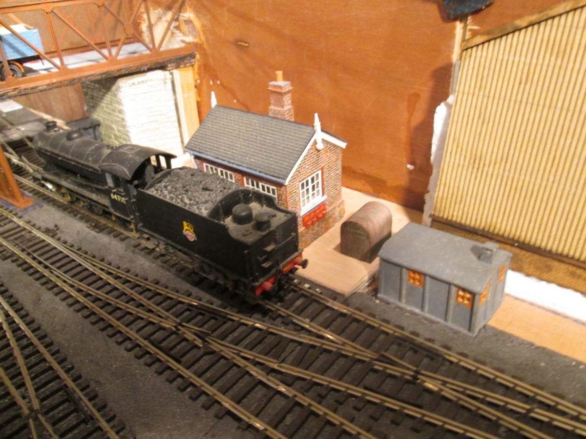 J39 64710 passes Ainthorpe Junction signal cabin. Gnger's hut and coal storage shed have been added to make up the scene ...