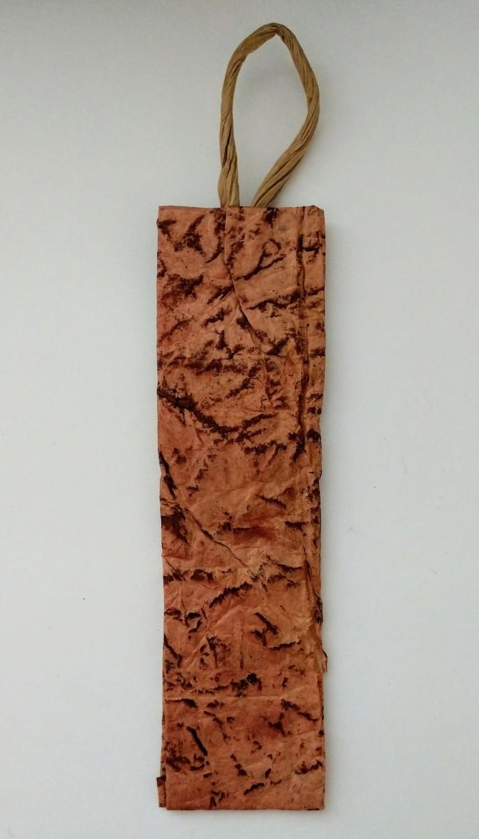 Bookmark with shoe polish dry brush