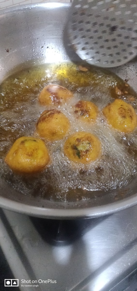 Deep fry the balls in the heated oil until it reaches light brown color.