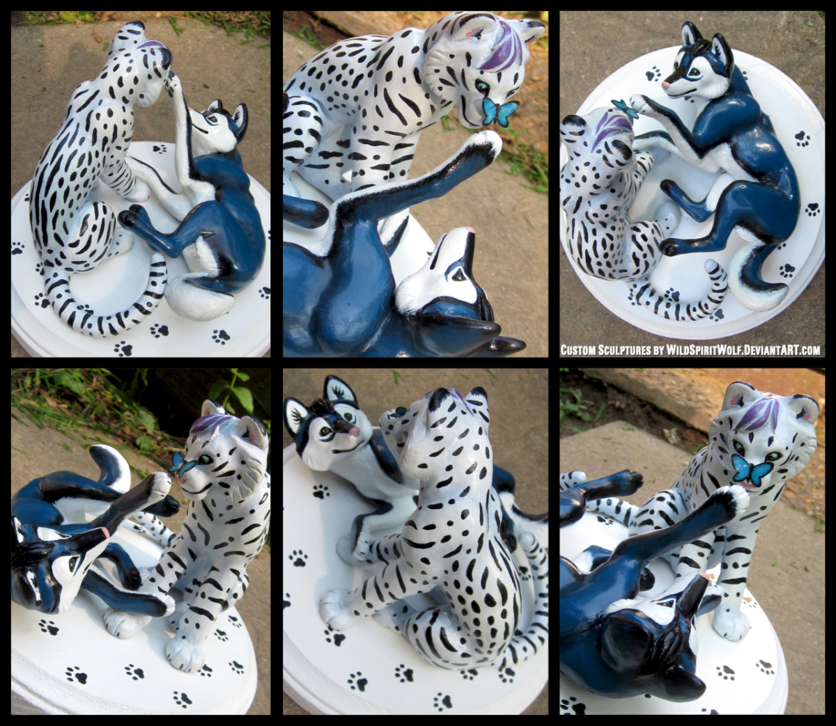 This white tiger and blue canine are an odd match, but beautiful nonetheless. There is even a butterfly to add a hint of playfulness to the pair's interaction.
