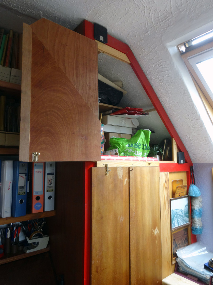 New folding, door fitted to cupboard above wardrobe; in open position.