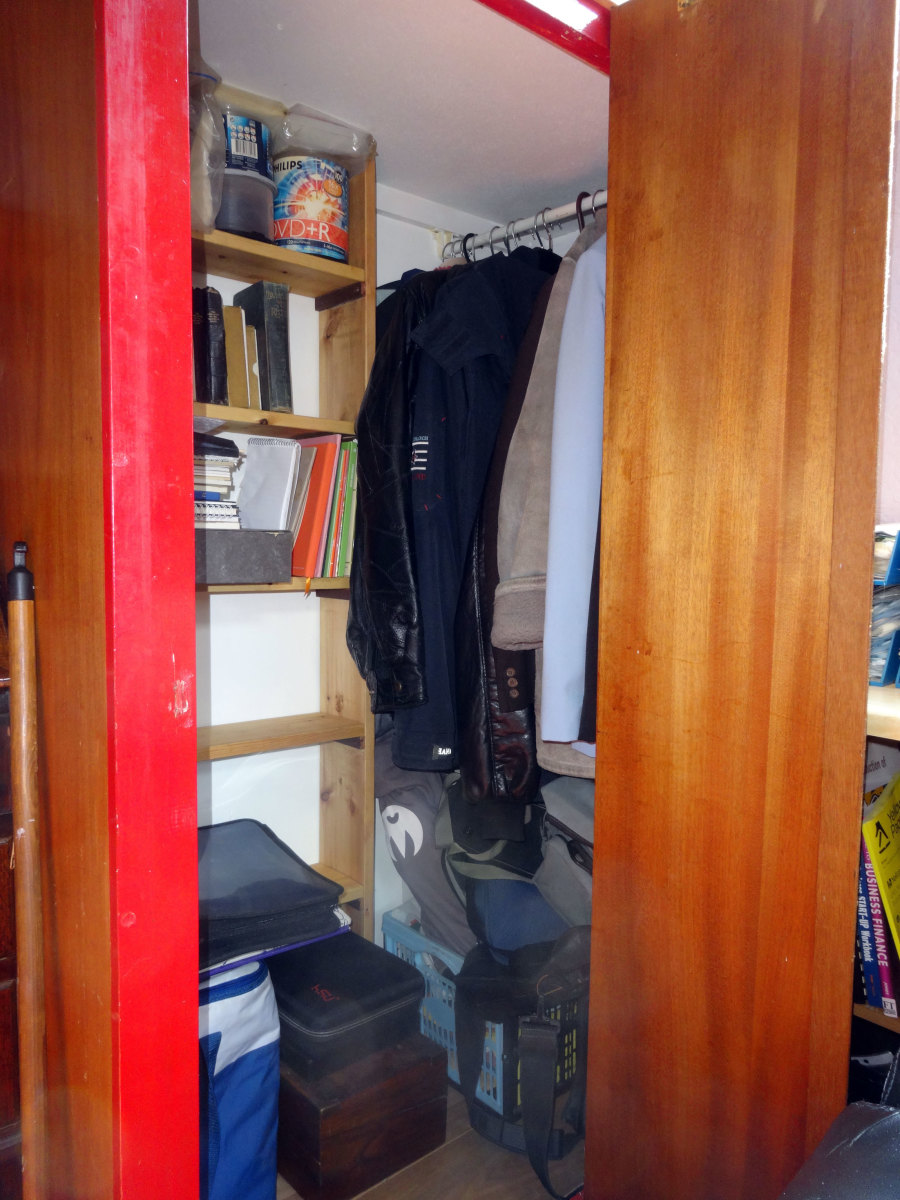 Relocated clothes rail, and new bookcase inside the wardrobe.