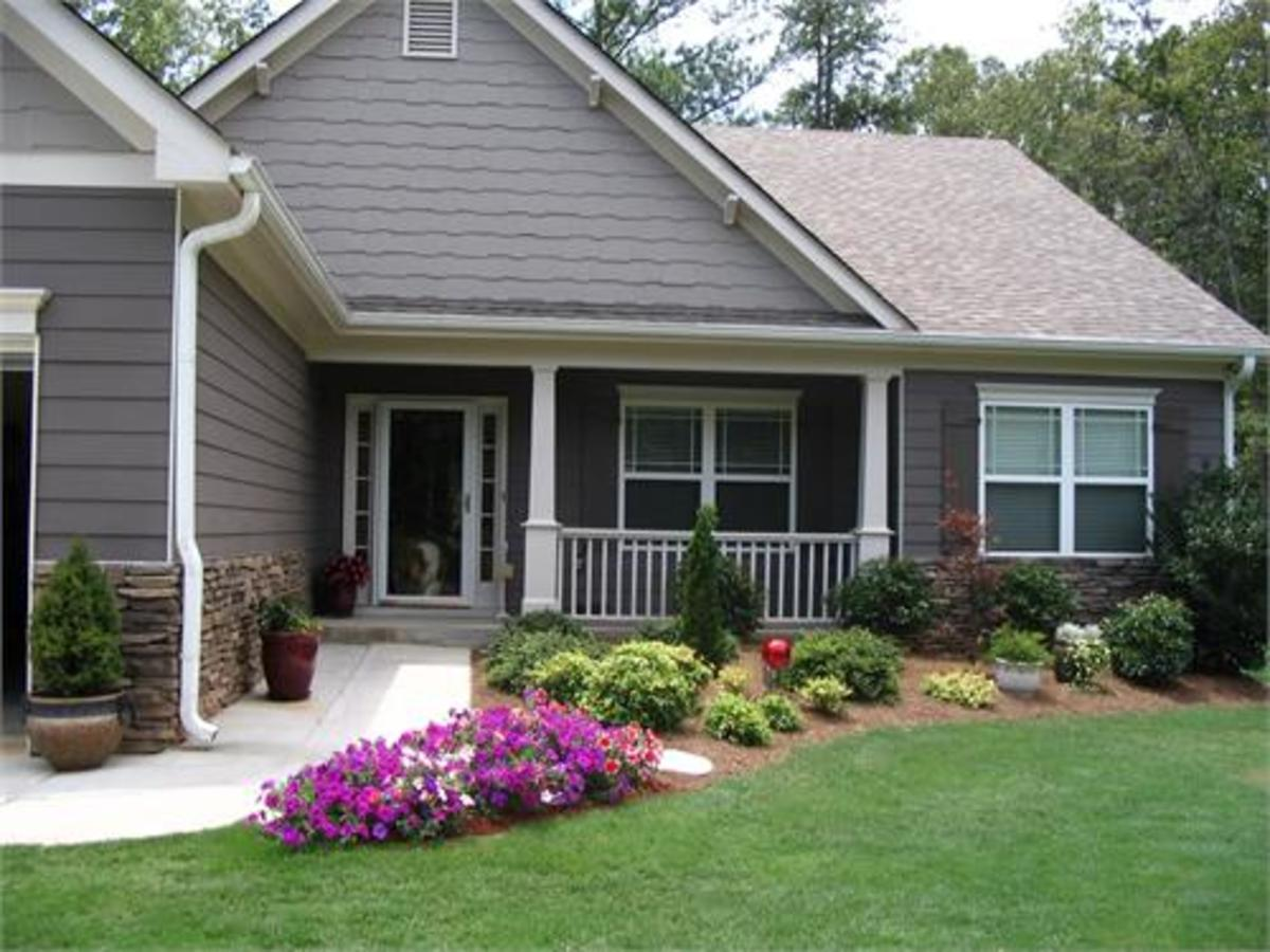Keep vegetation away from the home and densely landscaped planting beds in the middle of the mowed lawn