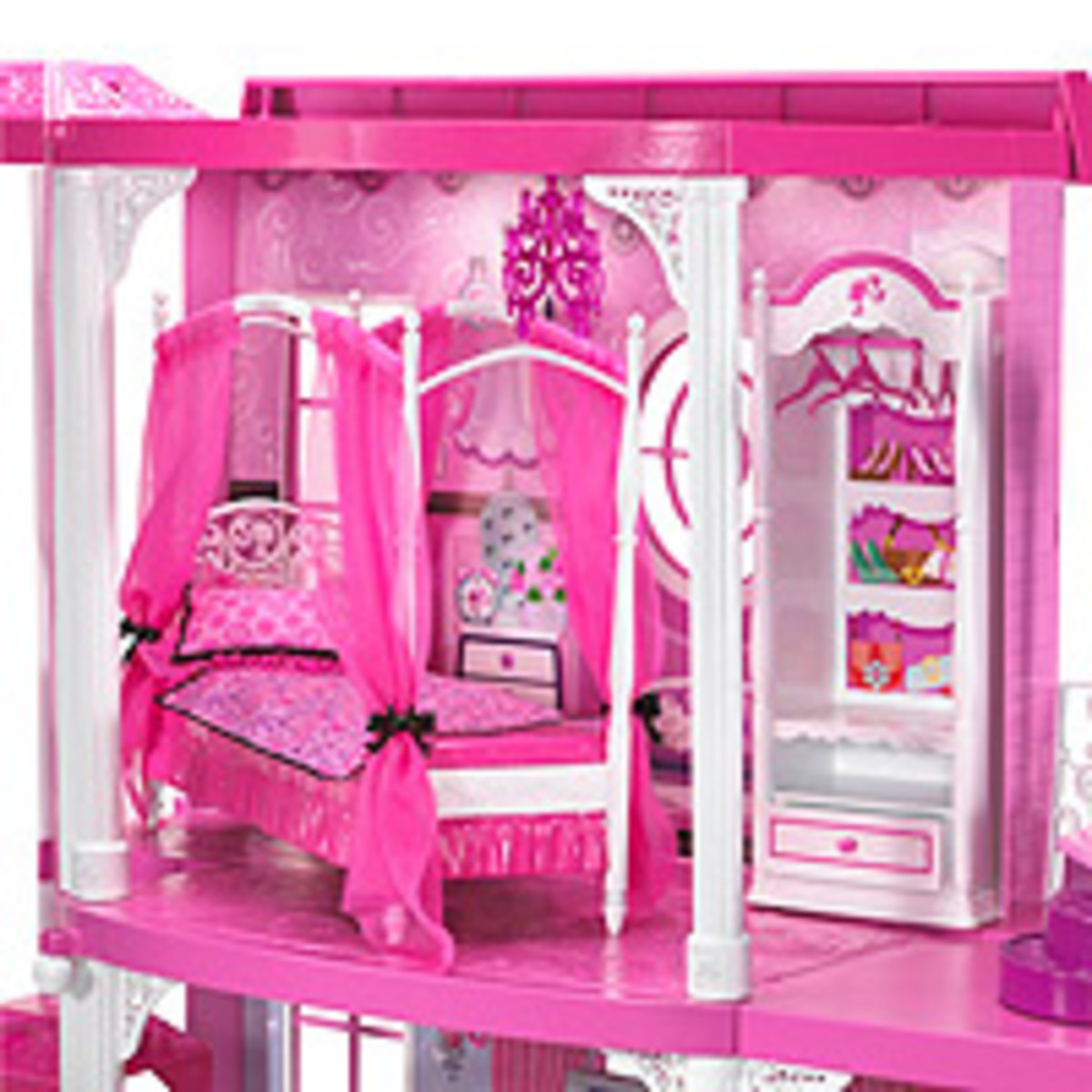 Barbies Bedroom suite is upstairs and it has a dreamy canopy bed, with a spacious wardrobe and cyrstal chandelier.