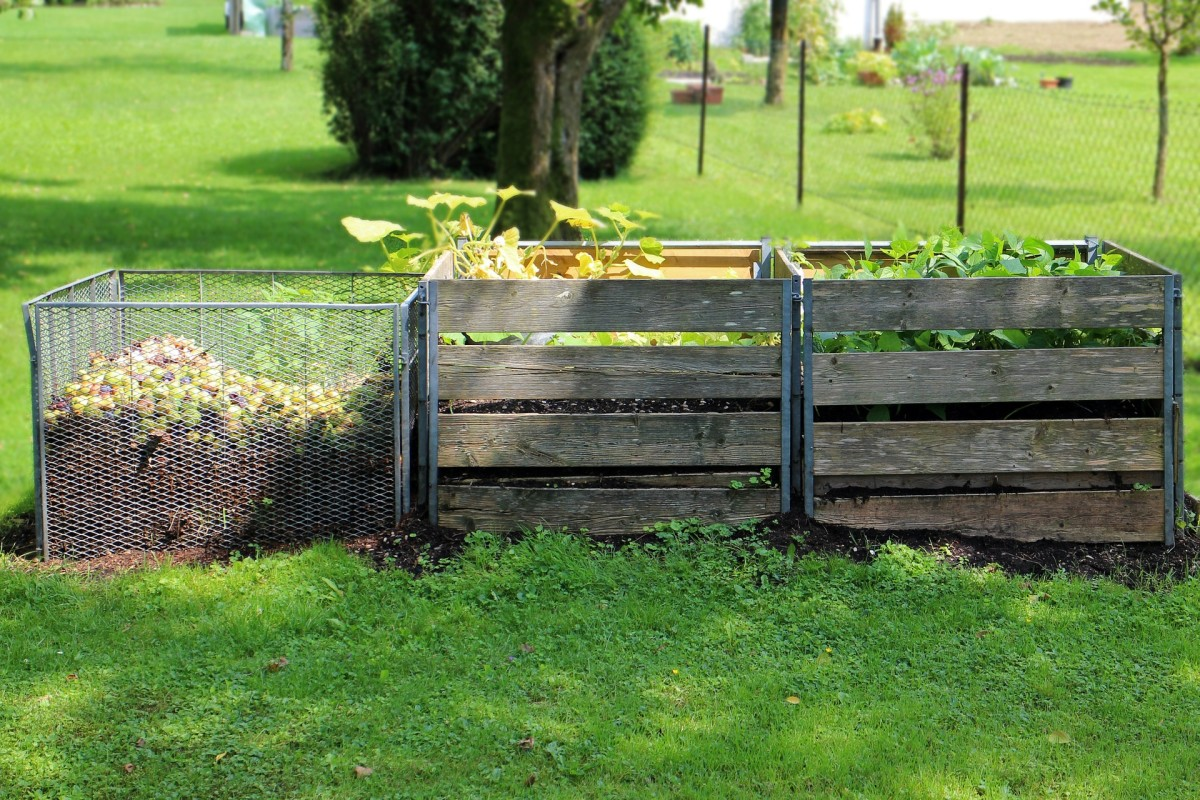 Here's an example of a nice outdoor compost area with the compost box right next to the garden boxes.