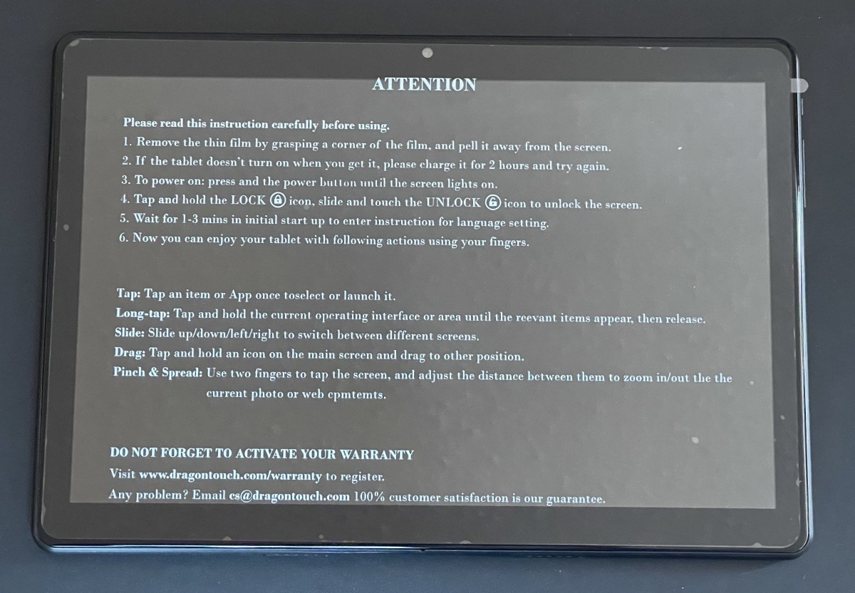 The screen protector displays setup instructions.