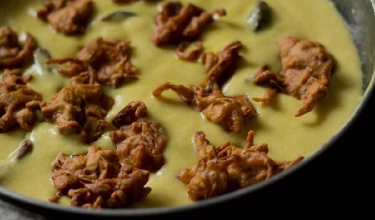 Onion pakora added in the Punjabi kadi.