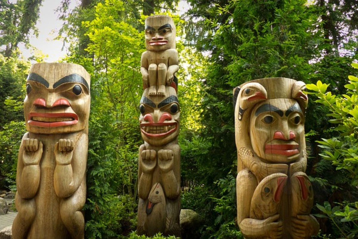 Carved cedar poles located in Canada.