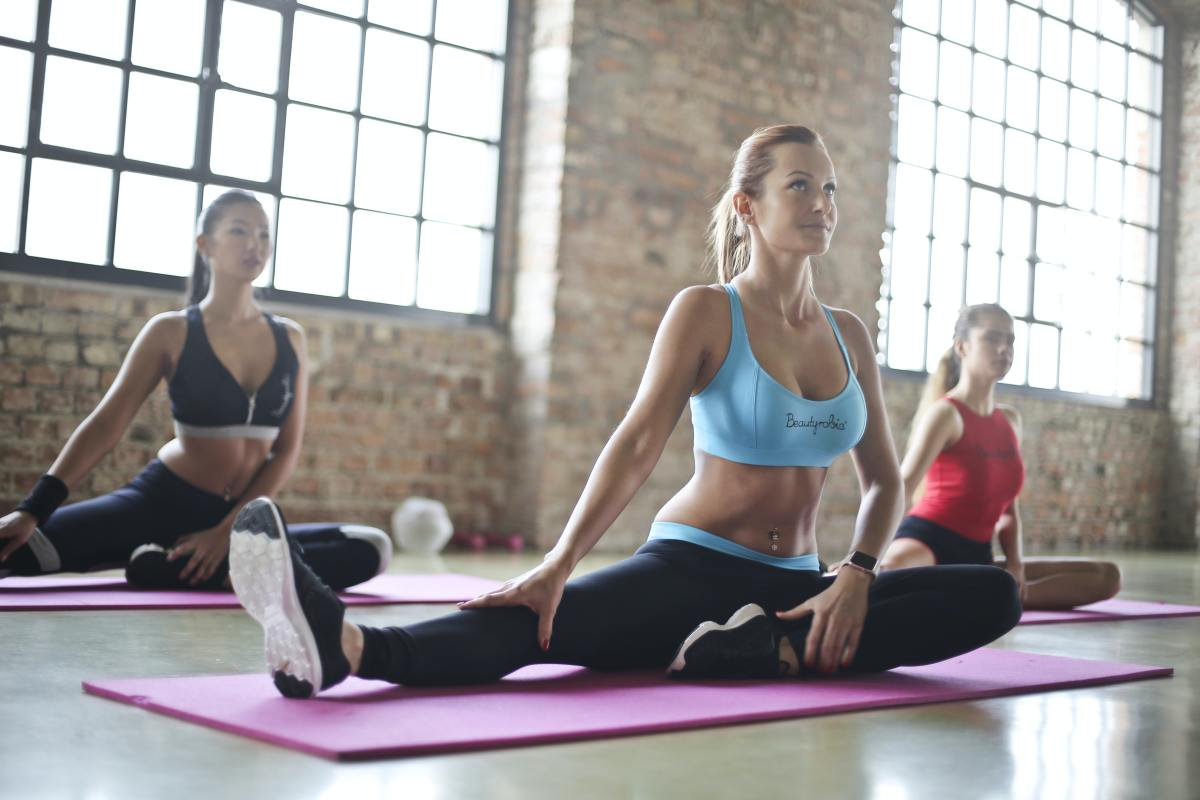 Three Woman Doing Yoga Exercises