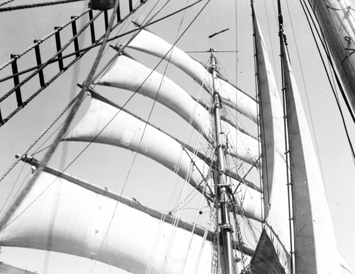The mast of a tall ship taken aback. Note how the sails push against the mast--they aren't meant to do this.