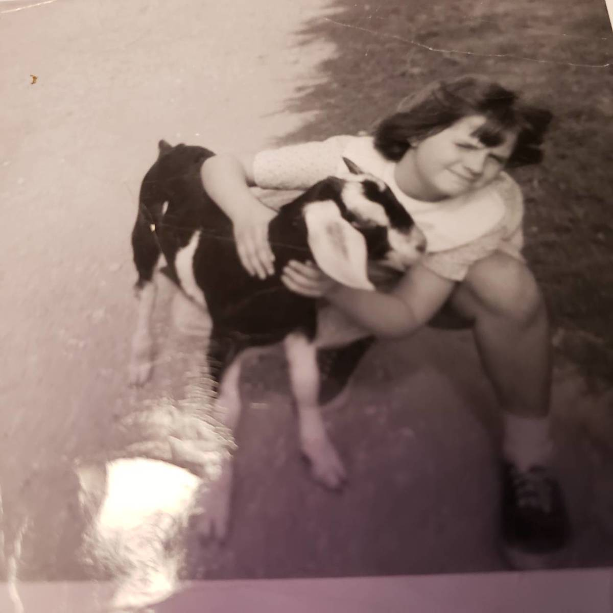 Connie with a goat on our farm.  She was about 8.