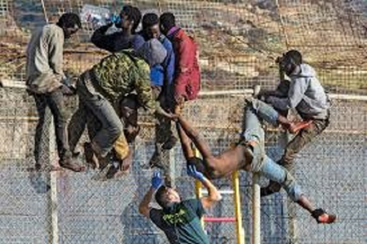immigrants at the border fence