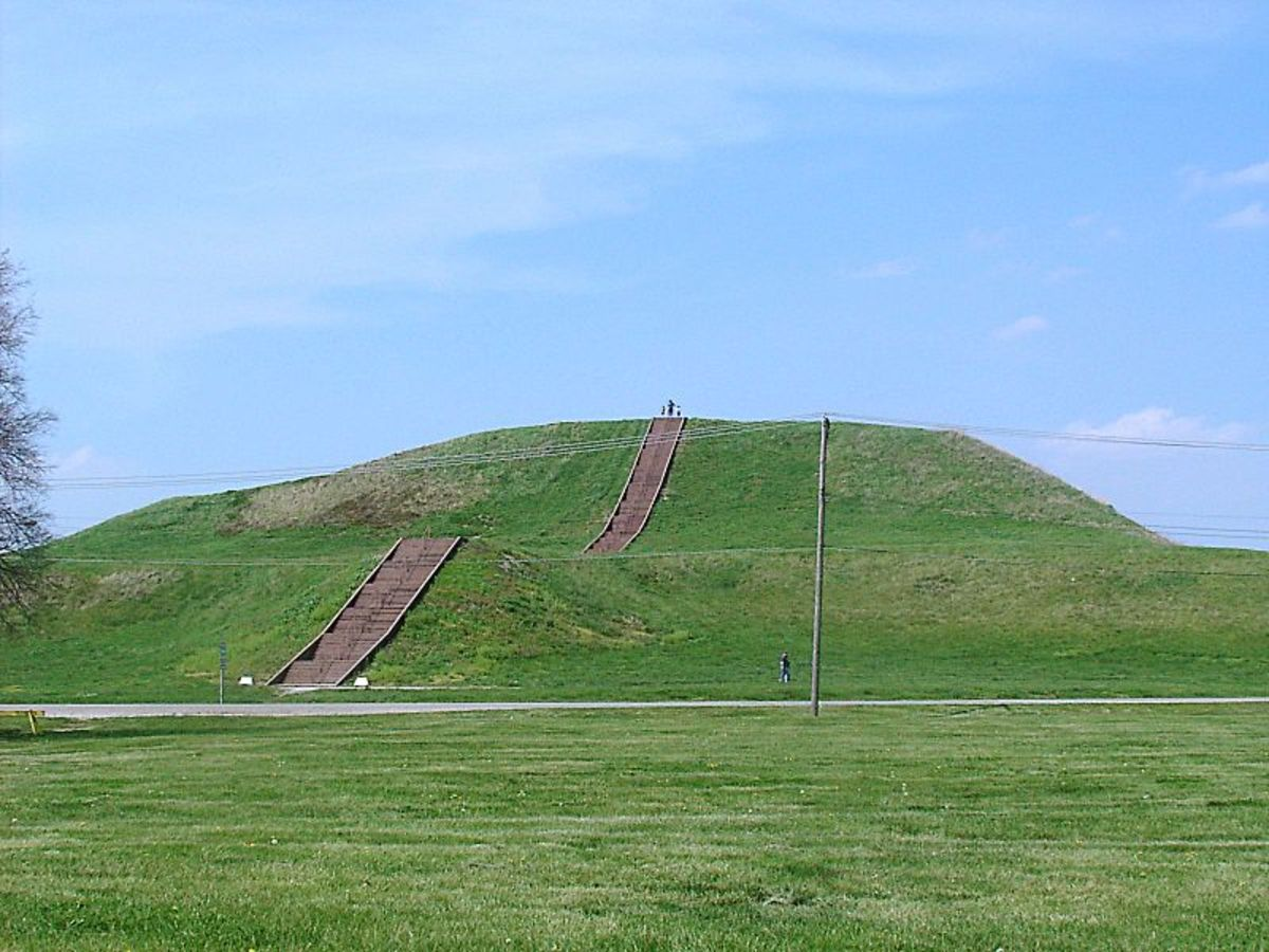 Monks Mound, built c. 950-1100 CE and located at the Cahokia Mounds UNESCO World Heritage Site near Collinsville, Illinois.  The concrete staircase is modern, but it is built along the approximate course of the original wooden stairs.