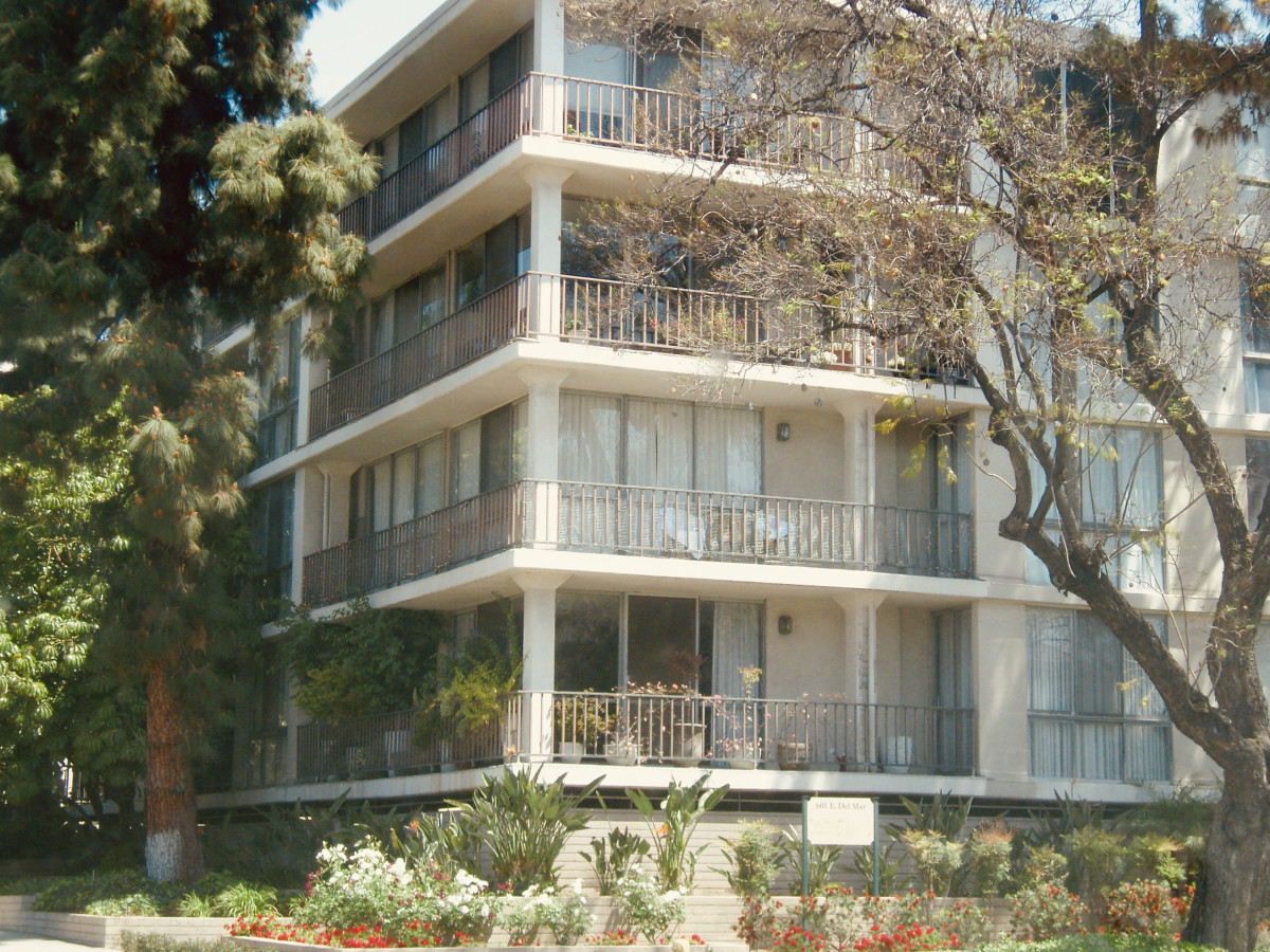 Imagine how gorgeous this apartment building in Southern California would look with flowers cascading from each balcony like colorful waterfalls. The flowers could attract passersby, while still screening people sitting on the balcony.